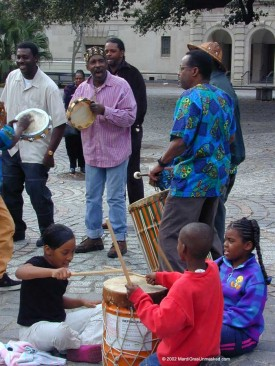 In colonial times, the focal point of Afro-Caribbean culture was the Place des Negres, later renamed Congo Square. Until it was suppressed around 1835, Congo Square was a public market and venue for communal drum-and-dance convocations, providing continuity for African forms of festive merriment. The percussive rhythms and call-and-response chants that drove the revelry entered the vernacular of Mardi Gras and New Orleans music.